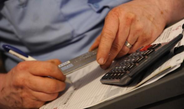 Man with credit card - Photo by Wonderlane