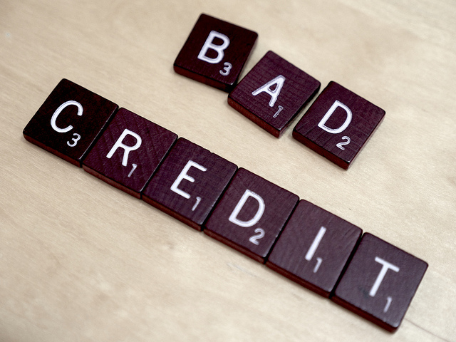 Bad Credit Written In Scrabble - By Simon Cunningham