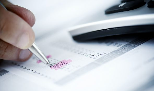 How Invoice Factoring Could Benefit Your Business - A Man Calculating Invoices