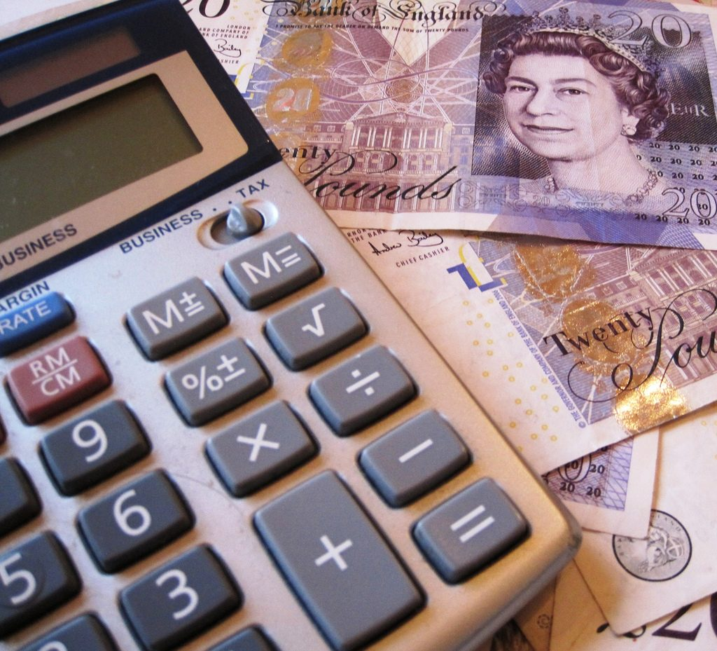 How Invoice Factoring Could Benefit Your Business - Calculator & Twenty Pound Notes