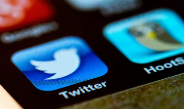 You'll Soon Be Able To Write Longer Tweets, But Should You? iPhone With Twitter App