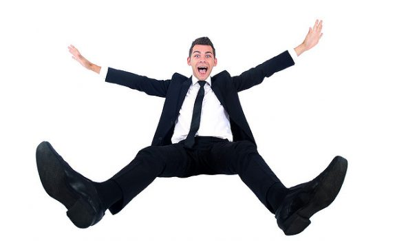 How To Keep Your Employees Happy - Smiling Man In Suit