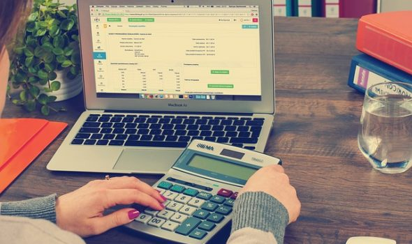 Rational Financial Thinking Is A Must In Today's World, According to VTA Publications' CEO - Laptop & Calculator